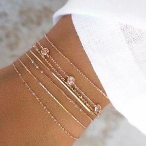 3/$33 7 Piece Gold Bracelet Set